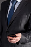 Businessman holding cellphone Royalty Free Stock Image