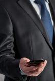 Businessman holding cellphone Stock Photos