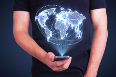 Businessman holding cellphone. With digital world map interface Stock Photography