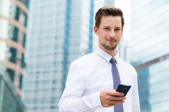 Businessman holding with cellphone Royalty Free Stock Photography
