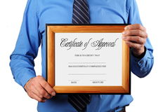 Businessman holding certificate Stock Photography
