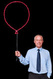 Businessman holding a chalk balloon Stock Images