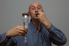 Businessman holding a champagne glass with camera focus on the glass Stock Photo