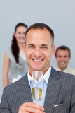 Businessman holding Champagne with his team Royalty Free Stock Photo