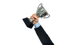 Businessman holding a champion silver trophy on white background Stock Photography