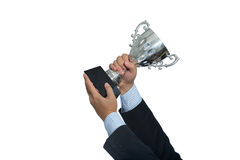 Businessman holding a champion silver trophy on white background Stock Image