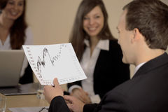 Businessman holding a chart Royalty Free Stock Image