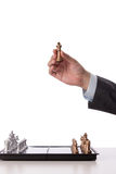 Businessman holding chess item Royalty Free Stock Image