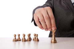 Businessman holding chess item Stock Images
