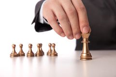 Businessman holding chess item Stock Photo