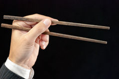 Businessman Holding Chopsticks Royalty Free Stock Photos