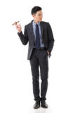 Businessman holding a cigar Royalty Free Stock Image