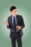 Businessman holding a cigar Stock Photography