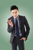 Businessman holding a cigar Stock Photos
