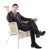 Businessman holding a cigar stock images