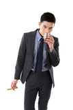 Businessman holding a cigar Royalty Free Stock Images
