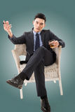 Businessman holding a cigar Stock Image