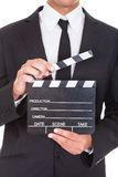 Businessman Holding Clapper Board Stock Photos