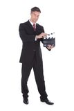 Businessman holding clapperboard Stock Image