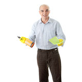 Businessman holding a cleaning accessories Stock Photography