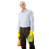 Businessman holding a cleaning accessories Royalty Free Stock Photo