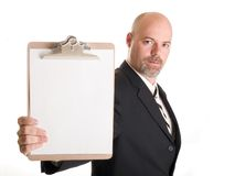 Businessman holding clipboard Royalty Free Stock Image