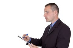 Businessman holding clipboard Stock Photos
