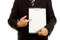 Businessman is holding a clipboard Royalty Free Stock Photo