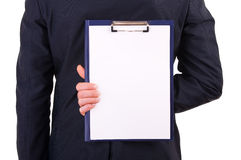Businessman holding clipboard behind back Stock Photos