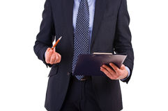 Businessman holding a clipboard. Stock Image