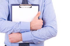 Businessman holding a clipboard. Royalty Free Stock Photography