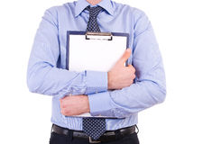 Businessman holding a clipboard. Stock Photo