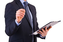 Businessman holding a clipboard. Royalty Free Stock Photos