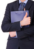 Businessman holding a clipboard. Stock Photography