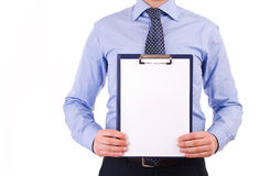 Businessman holding a clipboard. Royalty Free Stock Photo