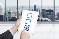 Businessman holding clipboard Royalty Free Stock Photo