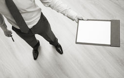 Businessman holding a clipboard with empty sheet of paper Royalty Free Stock Photo