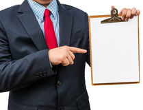 Businessman holding clipboard. Isolated on white background Royalty Free Stock Images