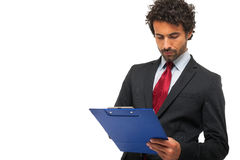 Businessman holding a clipboard Royalty Free Stock Photo