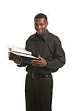 Businessman holding clipboard smiling isolated Stock Photography