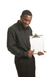 Businessman holding clipboard smiling isolated Royalty Free Stock Image
