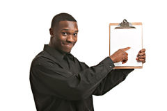 Businessman holding clipboard smiling isolated Royalty Free Stock Photography