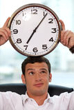 Businessman holding clock Stock Photography