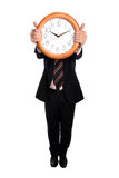 Businessman holding a clock Stock Photography