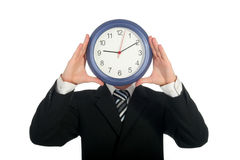 Businessman holding clock Royalty Free Stock Images