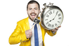 Businessman holding a clock and currency symbol Stock Images
