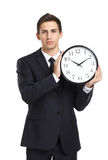 Businessman holding clock stock photography