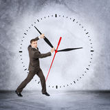 Businessman holding clock hand Royalty Free Stock Photography