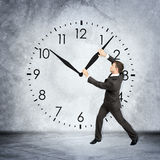 Businessman holding clock hand Stock Images