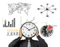 Businessman is holding clock  of head. Businessman is holding clock in front of head Royalty Free Stock Image